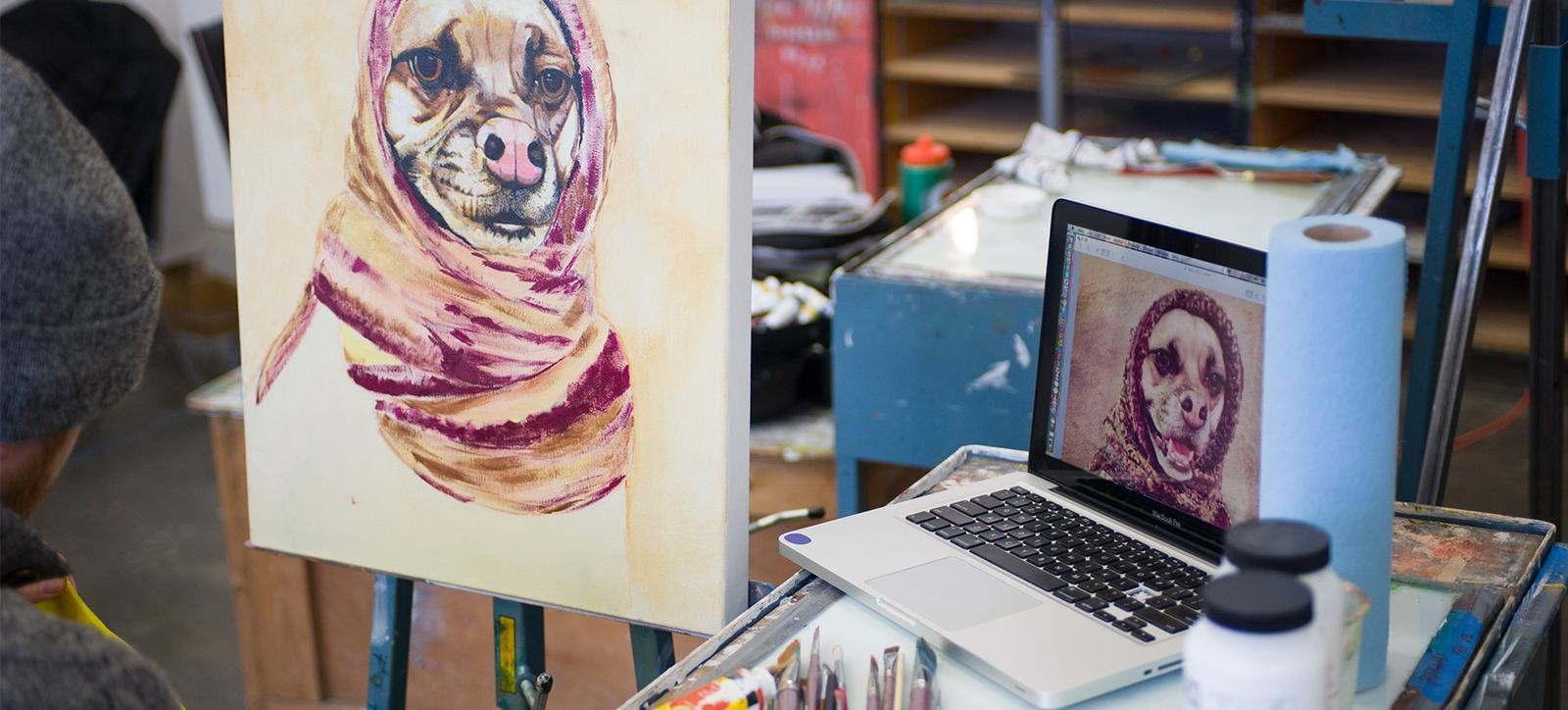 Student Painting pic of dog from computer